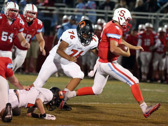 South Salem's Harrison Broadus runs the ball as the Saxons fall to South Salem 48-7 in a Greater Valley Conference game on Friday, Sept. 2, 2016, at South Salem.