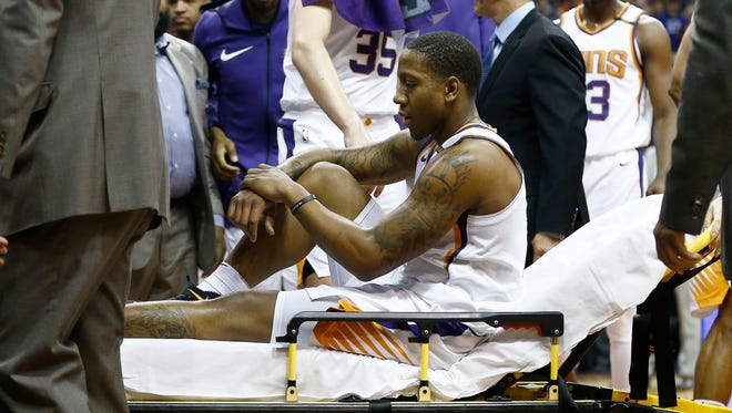 Phoenix Suns guard Isaiah Canaan is taken off the court due to injury during the first half of an NBA basketball game against the Dallas Mavericks, Wednesday, Jan. 31, 2018, in Phoenix.The Suns defeated the Mavericks 102-88.