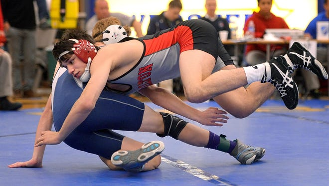 Hilton's Yianni Diakomihalis, front, pinned Gates-Chili's Derek St. James in the second period of the finals of the 138-pound weight class during the Monroe County League Wrestling Championships at Webster Schroeder High School on Dec. 19, 2015.