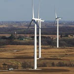 Wind turbines line the Madison County countryside as seen from the top of a turbine.