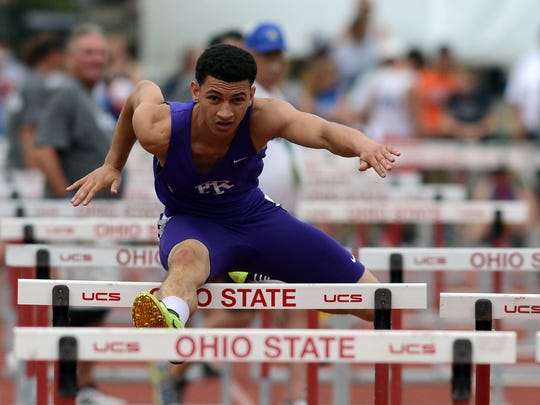 Elijah Johnson of Fremont Ross competes in the 110 hurdles preliminaries at state last season.