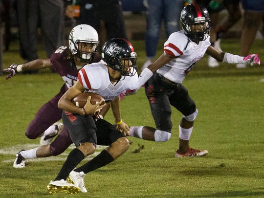 South Fort Myers High School's Jeshaun Jones scores a touchdown against Riverdale during first half play Friday at Riverdale High School. South Fort Myers beat Riverdale 31-13.