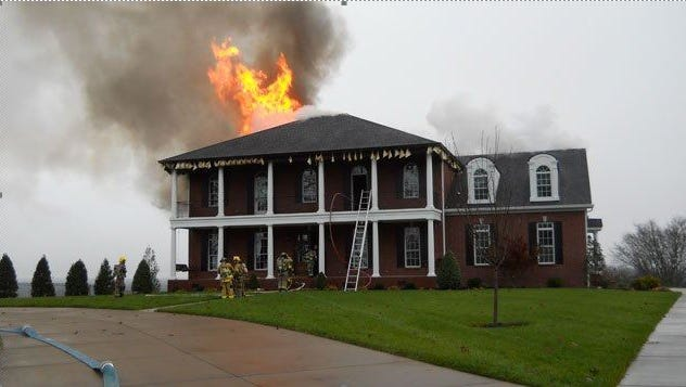 Firefighters respond to a home in flames at 3454 Shady Lane on Monday morning in the Lascassas community northeast of Murfreesboro. The firefighters were unable to save the $1 million home.