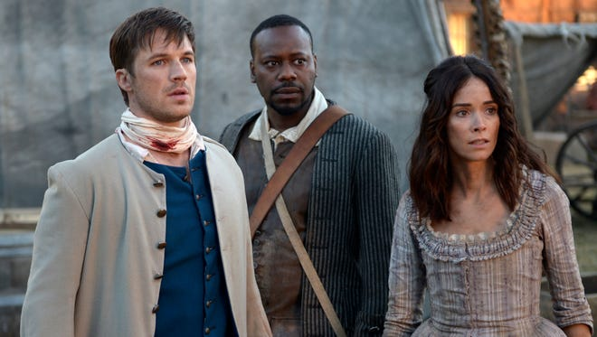 Matt Lanter as Wyatt Logan, Malcolm Barrett as Rufus Carlin, and Abigail Spencer as Lucy Preston in NBC's 'Timeless.'