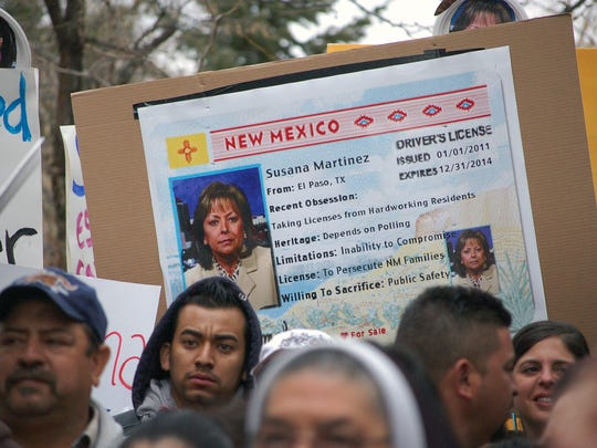 Immigrant advocates use an image of New Mexico Gov.