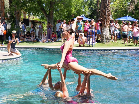 CATHEDRAL CITY, CA - APRIL 16:  The Aqualillies synchronized swimmers perform during the Pandora Indio Invasion at Cree Estate on April 16, 2016 in Cathedral City, California.