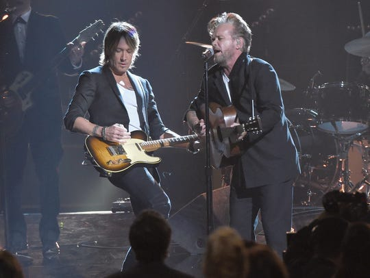 John Mellencamp, right, jams with Keith Urban at the
