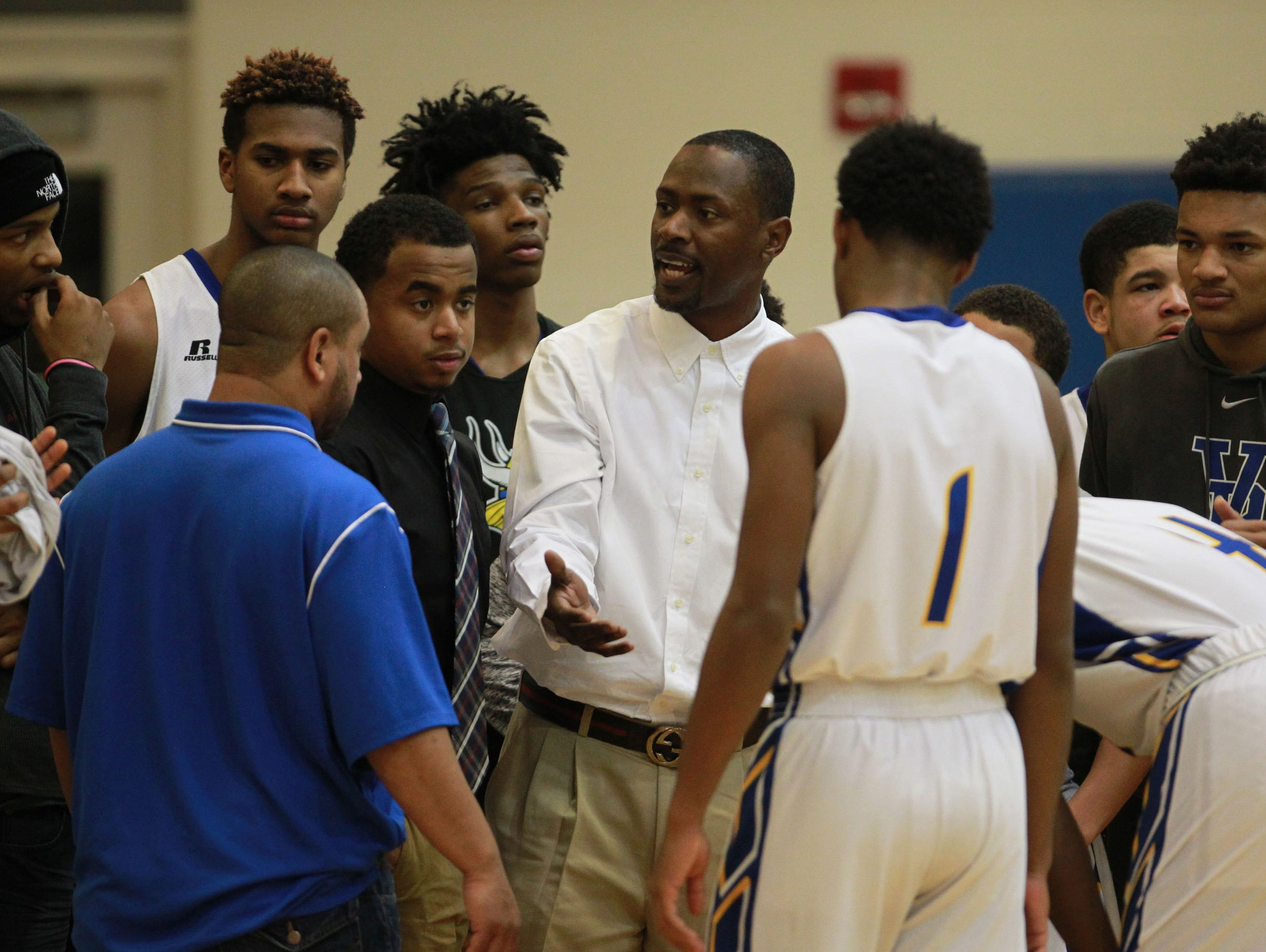Valley High School head coach DeJuan Wheat (C) talks with his team during a time out against Doss High School during the first half of play at Valley High School in Louisville, Kentucky. January 3, 2017