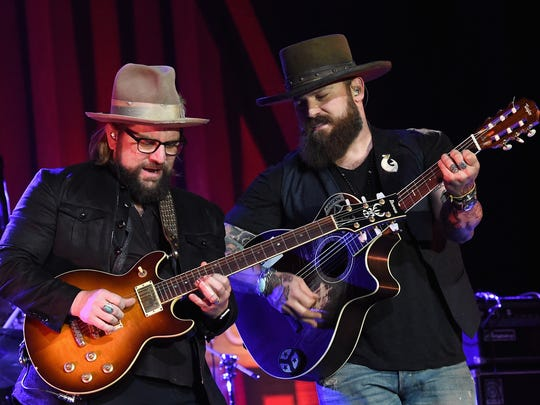 Coy Bowles and Zac Brown of the Zac Brown Band perform