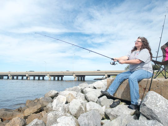 Brenda Catalanotto, of Pensacola, fishes at Wayside Park in Gulf Breeze on Wednesday, March 8, 2017.  Wayside Park will be closing on March 22nd to be used as a staging area for construction of the new Pensacola Bay Bridge.