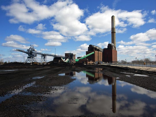 This April 12, 2016 file photo shows the coal-fired B.C. Cobb Plant generating station in Muskegon, Mich., which closed April 15, 2016. The global fleet of coal-fired power plants is projected to begin shrinking by 2022 as plant retirements outpace new construction, according to a new report that warns the heavily-polluting fuel's decline may not come quickly enough to meet international emission reduction goals.