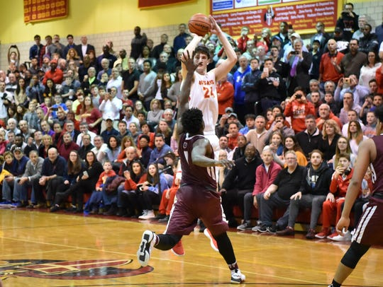Bergen Catholic Matt Zona (w24) scores the wining shot