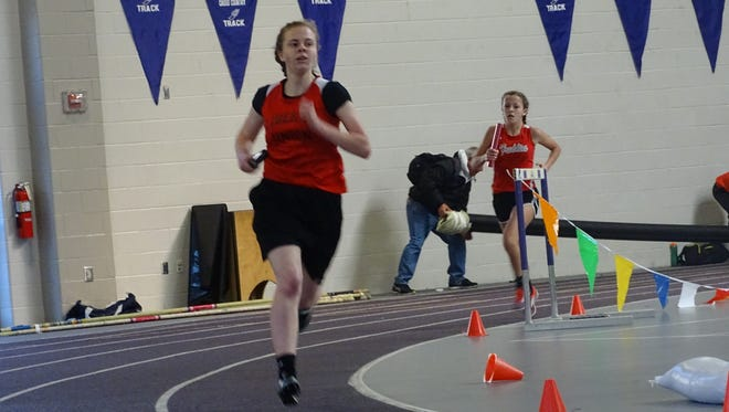 Liberty Union sophomore Elayna Miracle runs the third leg of the 4x800 on Sunday during the Division II-III Central District Indoor meet at Capital University.