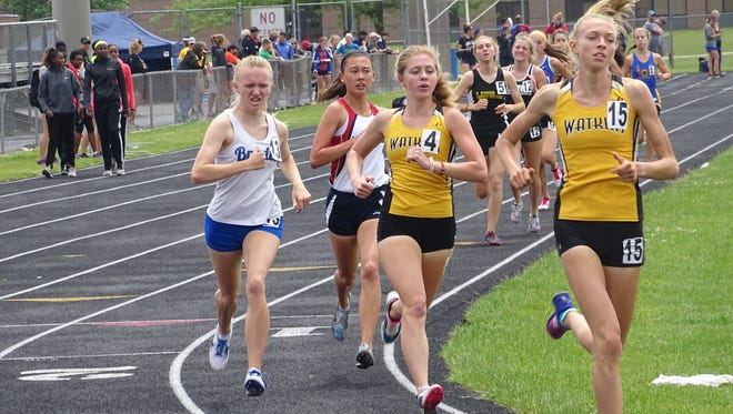 Watkins Memorial seniors Lindsey Finnegan and Raechal Schoenberger lead the pack during the 1,600 this past Saturday during the Division I District 2 meet at Hilliard Darby. Finnegan placed second and Schoenberger third.