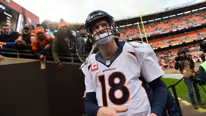Denver Broncos quarterback Peyton Manning (18) walks off the field after defeating the Cleveland Browns 26-23 at FirstEnergy Stadium.