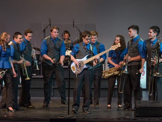 Jack Zondlo, center, played bass this summer with Kids
