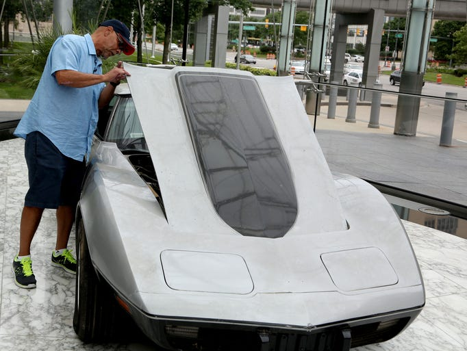 George Talley, 71, of Detroit popped the hood of his 1979 Corvette to see the condition of the engine and other parts after he was presented with the sports car on Tuesday, July 1, 2014 at GM World Headquarters in Detroit. Talley hadn't seen his Corvette since it was stolen off Jefferson Avenue in Detroit over 33 years ago.