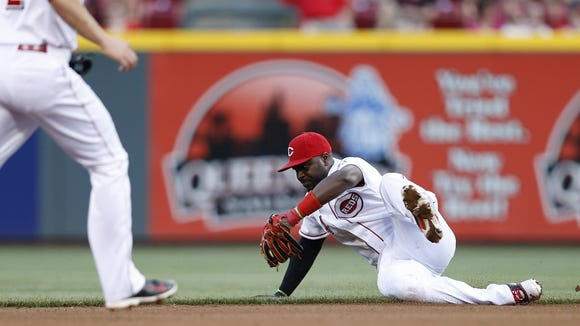 Cincinnati Reds second baseman Brandon Phillips (4) makes a play on the ball against the San Diego Padres at Great American Ball Park.