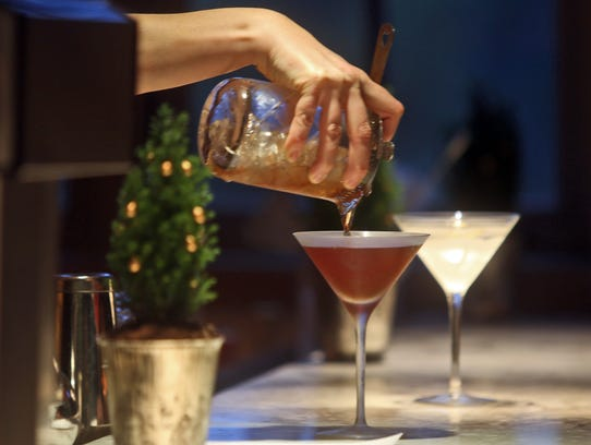 A drink is poured at the bar at the Inn at Pound Ridge by Jean-Georges.