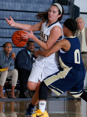 Haslett's Megan Mowid, left, is fouled by Detroit Country Day's Kaela Webb on a drive Tuesday, Feb. 2, 2016, in Haslett, Mich. Country Day won 69-56.