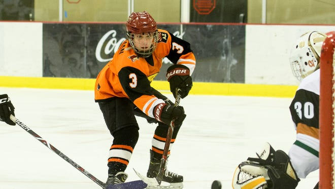 Corona del Sol's Noah Steinman (3) takes a shot on Campo Verde's Steven Pryce in the first period of their championship game on Saturday, Feb. 3, 2018, at the Ice Den Scottsdale in Scottsdale, Ariz.