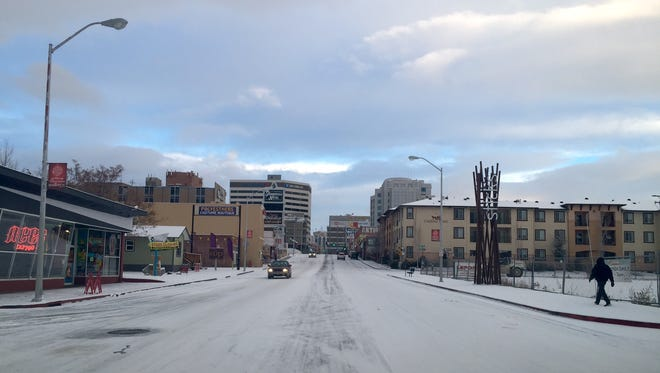 Virginia Street in Midtown was covered in snow this morning, Dec. 30, 2014.
