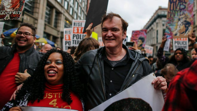 Director Quentin Tarantino at the march to denounce police brutality in Washington Square Park October 24, 2015 in New York City.