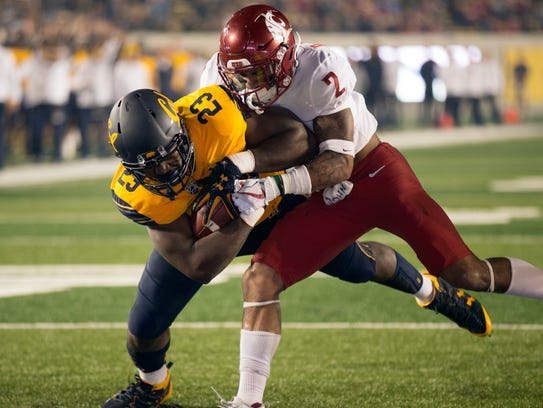 California's Vic Enwere (23) drags Washington State's