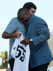 Bubba Watson presents Derrick Brooks with his very
