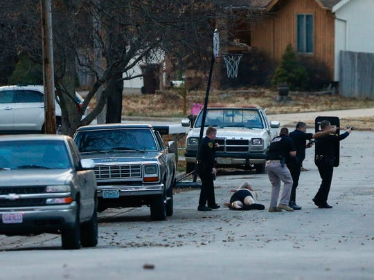 Police take a man into custody after surrounding a home on the 1600 block of Whiteside Street on Wednesday, Jan. 11, 2017. A woman was found inside the house with fatal injuries according to police.