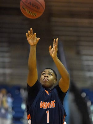 Wayne County's Reggie Stewart (1) shoots three pointer against Oxford on Thursday, March 5, 2015, in the MHSAA state basketball tournament at the Lee E. Williams Athletics & Assembly Center on the Jackson State University campus in Jackson, Miss.