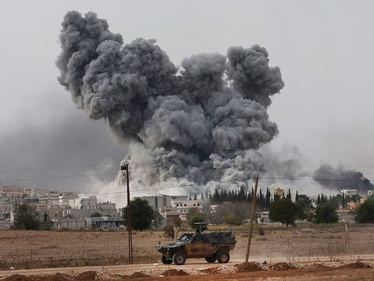 Smoke rises following an airstrike by the US-led coalition