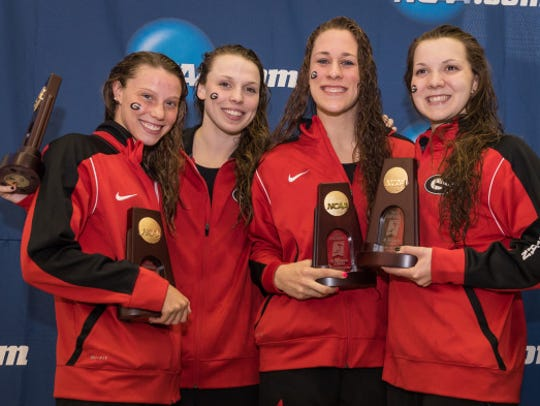 Hali Flickinger, left, was part of the 4x200 free relay