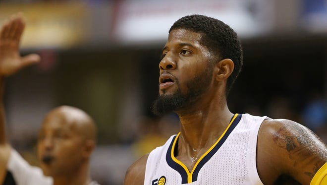 Indiana Pacers forward Paul George (13) watches after sinking a three point shot during first half action against the Chicago Bulls, Banker's Life Fieldhouse, Indianapolis, Thursday, October 6, 2016.