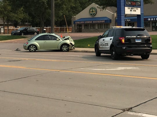 Sioux Falls police attend to a collision on South Sycamore Avenue on Sept. 4, 2017.