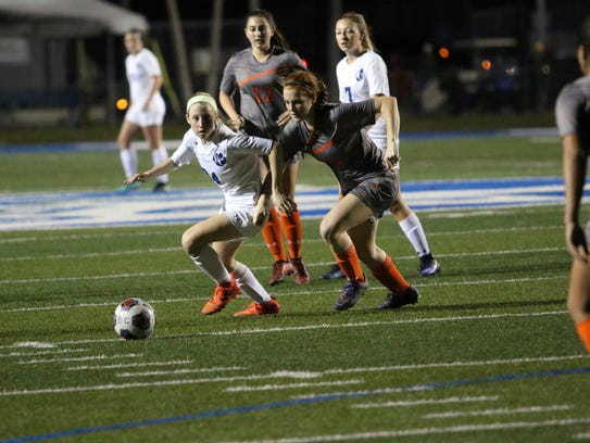 Barron Collier sophomore Rachael Basik dribbles up the field during the first half of the Class 3A-District 14 championship game between the Cougars and Lely on Friday.