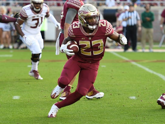 FSU sophomore running back Cam Akers runnning to the