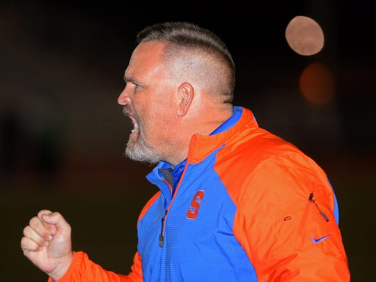Southwood head coach Anthony McClain yells to his team during a game last season.