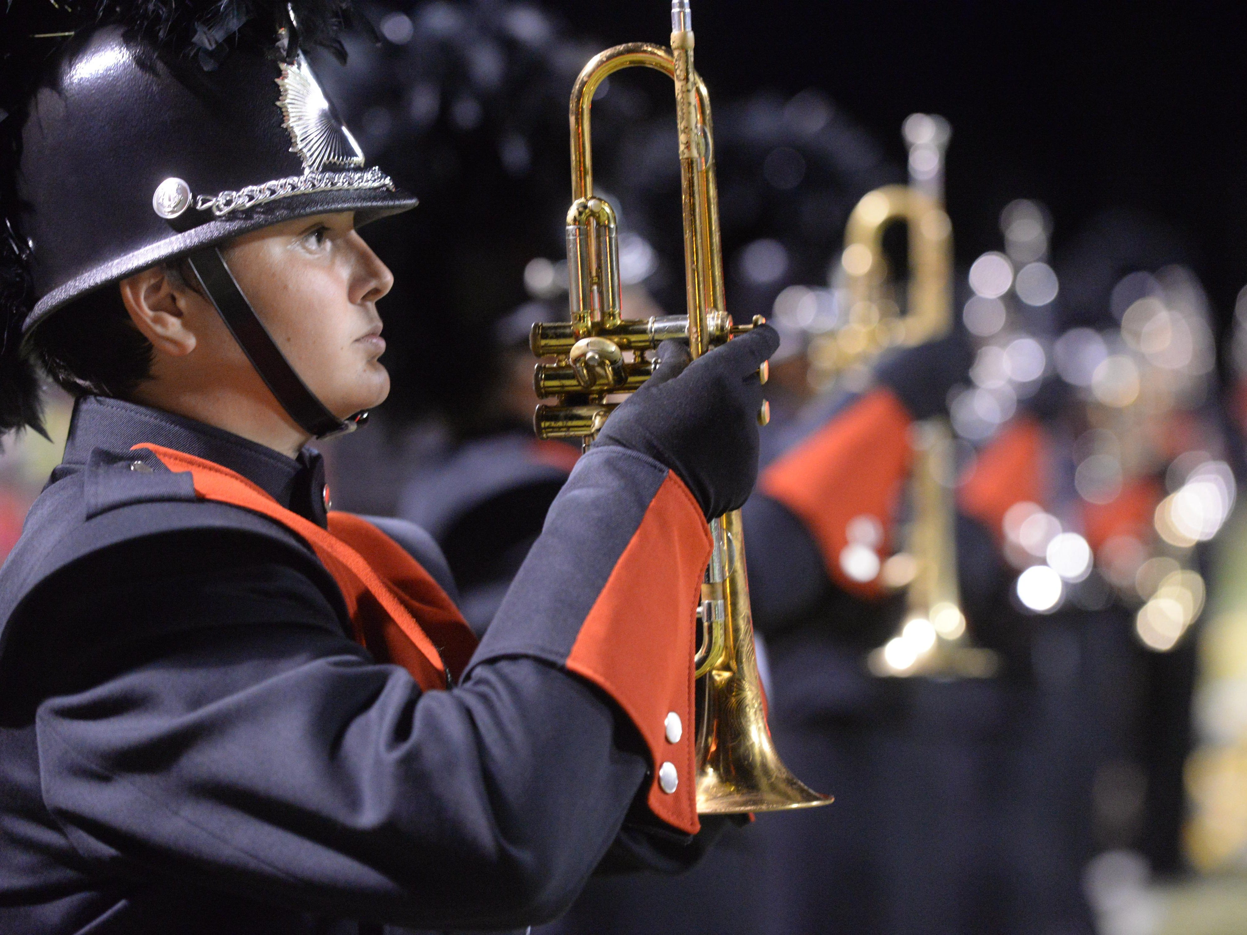 The Parkway High School marching band pauses before taking the field for their halftime show.