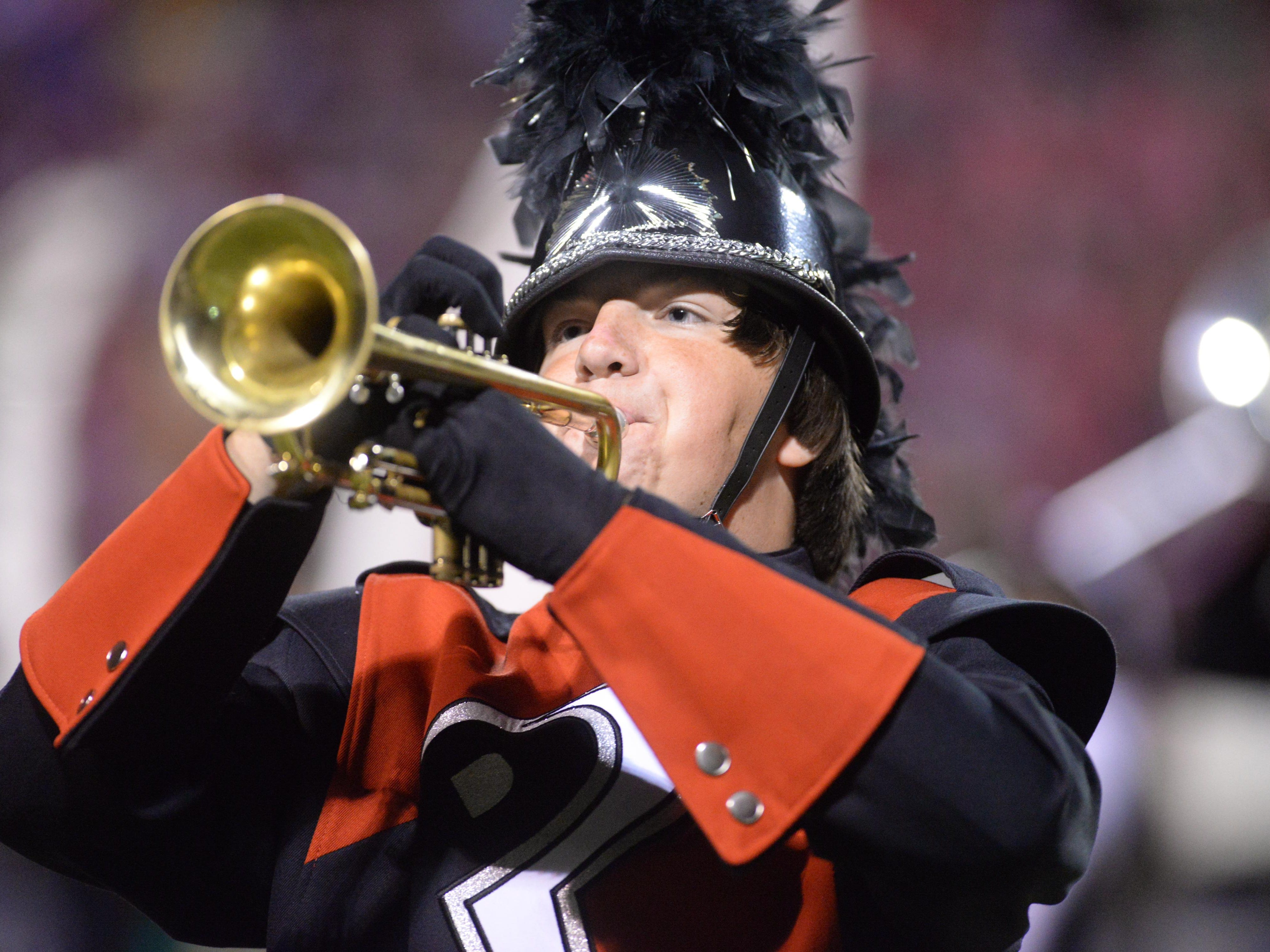 A trumpet sounds during the halftime show of the Parkway High School football game October 2, 2015.