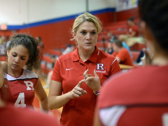 Ruston volleyball coach Amanda Cauley talks with her team between games.