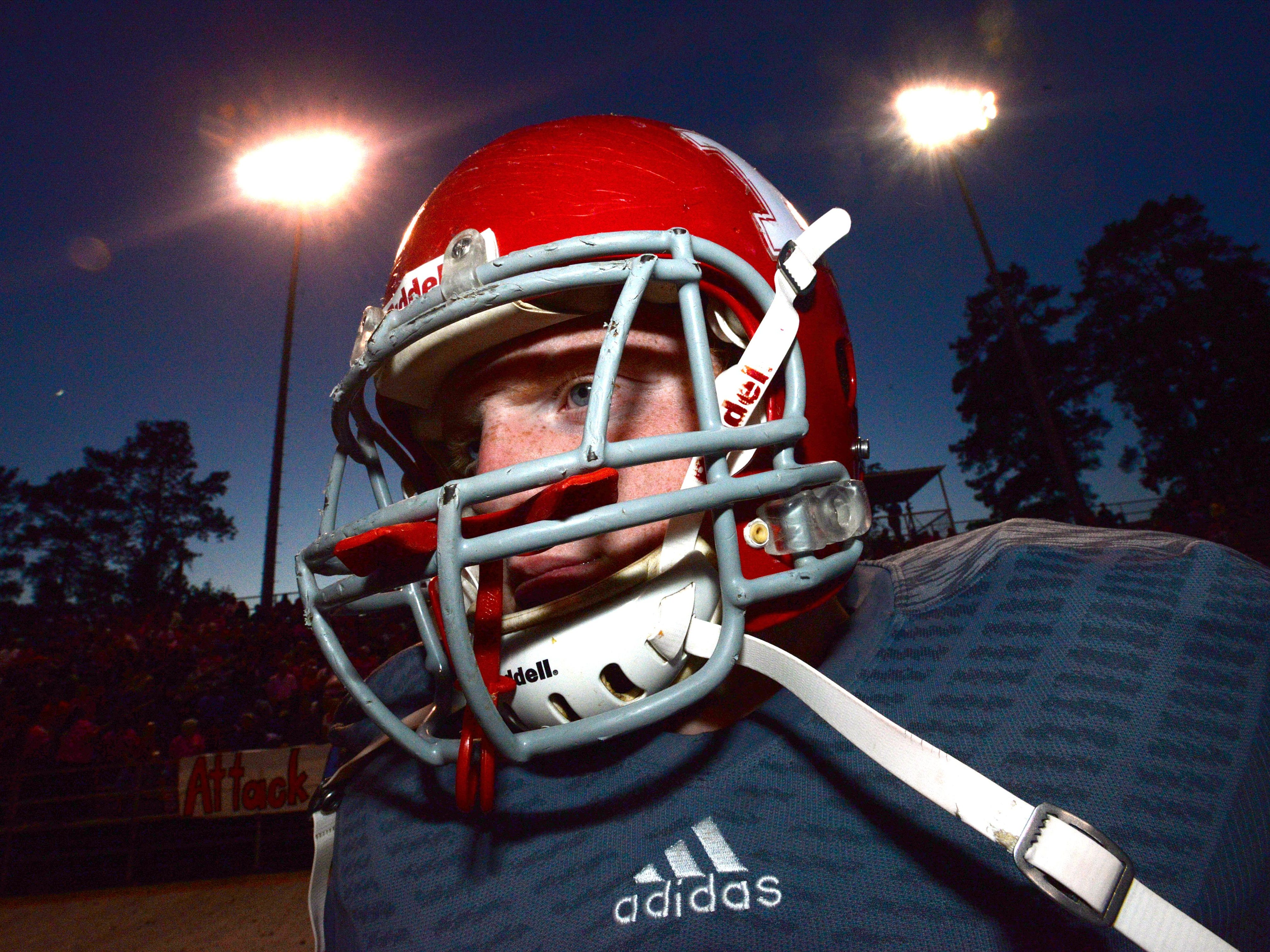Haughton center Jonathon McClesky has his helmet on as he prepares to take the field against Airline High School.\