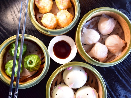 Exotic delights, from left: spinach dumplings, shrimp shui mai, shrimp dumplings and steamed creamy custard buns at Aquarius in Fort Lee.