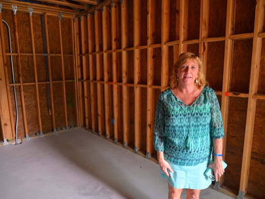 Promise co-founder Betsy Farmer standing on of the apartments at the complex, which is scheduled to open this fall.