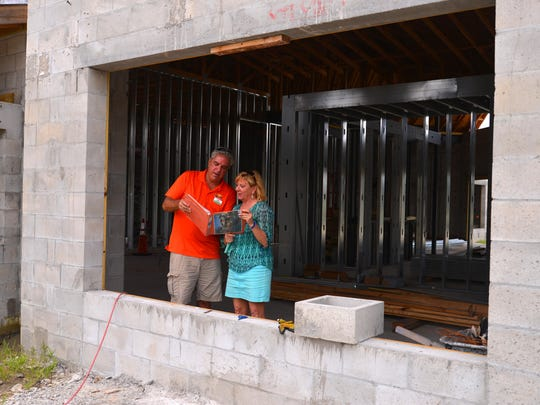 Brian Nemeth, the director of culinary operations for the Promise Café and Bakery, talks with Promise co-founder Betsy Farmer about the future of the program at the site under construction. The cafe is scheduled to open in October.