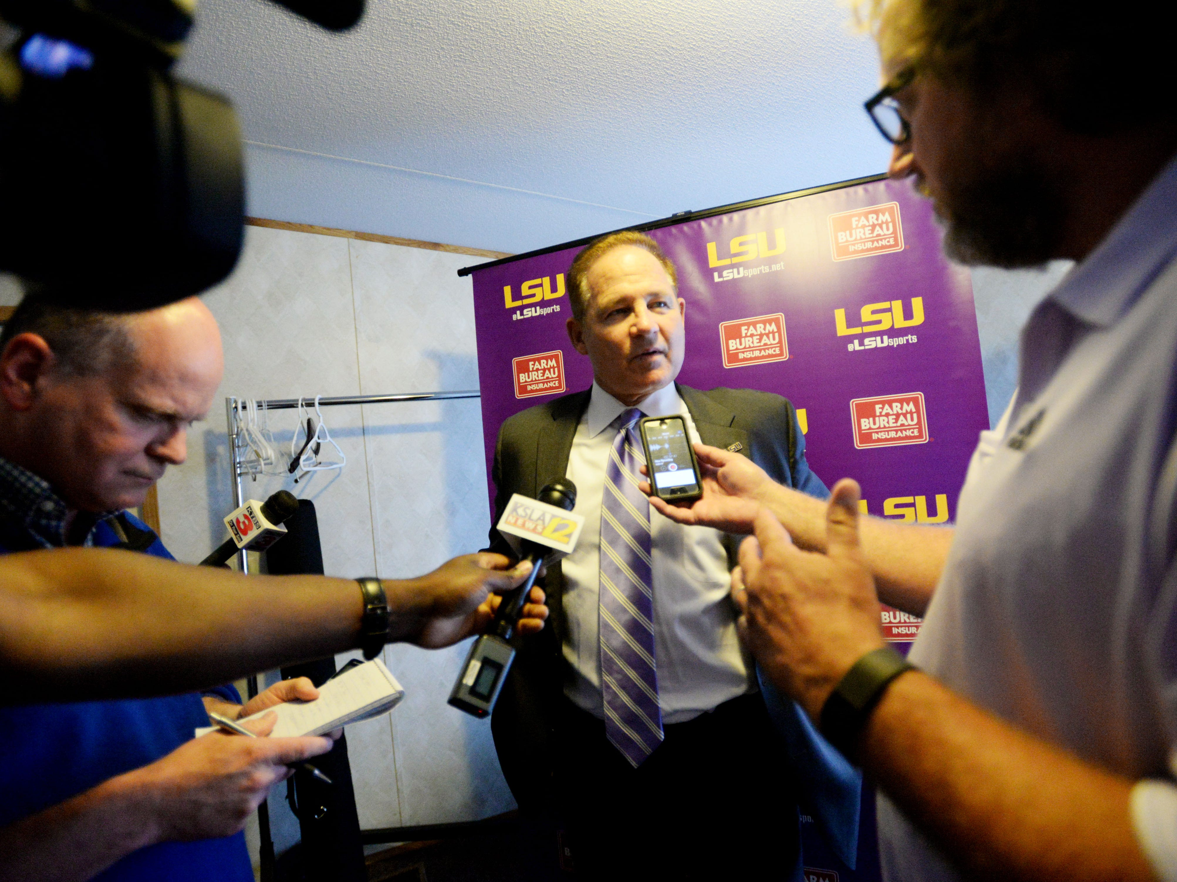 LSU football coach Les Miles speaks to reporters moments before the Tiger Tour dinner at the Horseshoe Riverdome Monday evening.