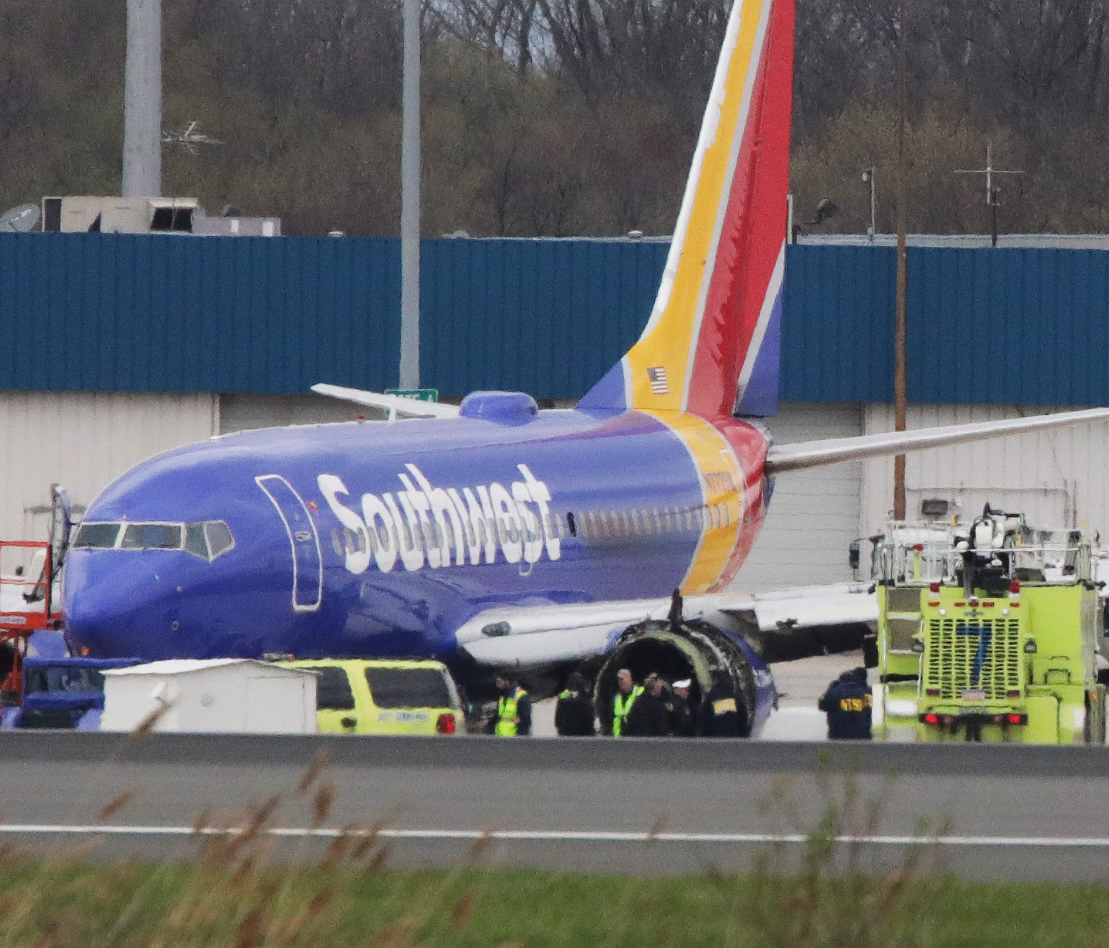 Southwest Airlines Flight 1380 sits on the runway at Philadelphia International Airport after it was forced to land with an engine failure,  April 17, 2018.