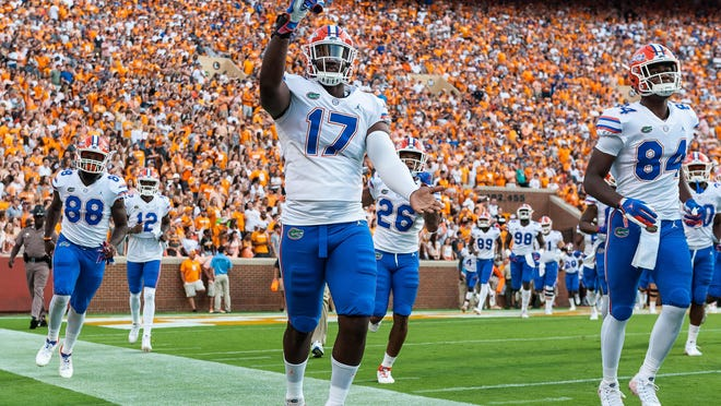In this 2018 photo, Florida Gators defensive end Zachary Carter (17) takes the field before a game against the Tennessee Volunteers in Knoxville, Tennessee.