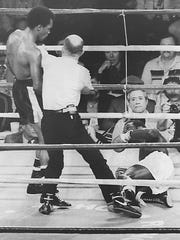 Sugar Ray Leonard, being held back by referee Mills Lane after knocking down Bruce Finch in their 1982 fight in Reno, was the Olympic gold medalist at the 1976 Games in Montreal.