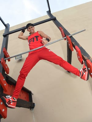 American Ninja Warrior athlete Billy Navarrete poses for pictures at iFit Guam in Tamuning on March 28.